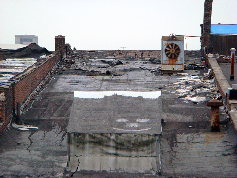 Deteriorated roof on the Iron Quarter buildings (BS File Photo)