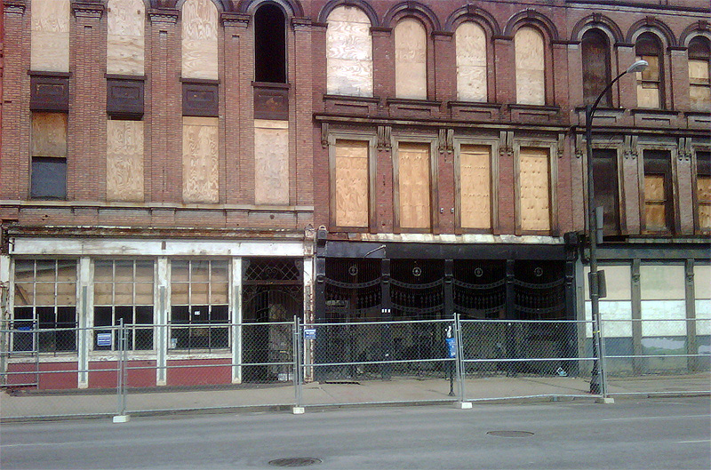 Fence installed on Main Street at the Iron Quarter site (Photo courtesy tipster)