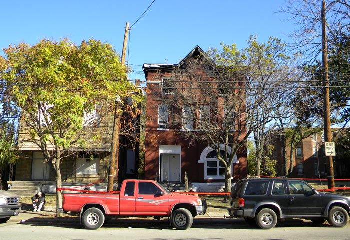 923 First Street after a fire (Broken Sidewalk)