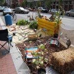 Folk art fills a Park(ing) Day park on West Main Street. (Branden Klayko)