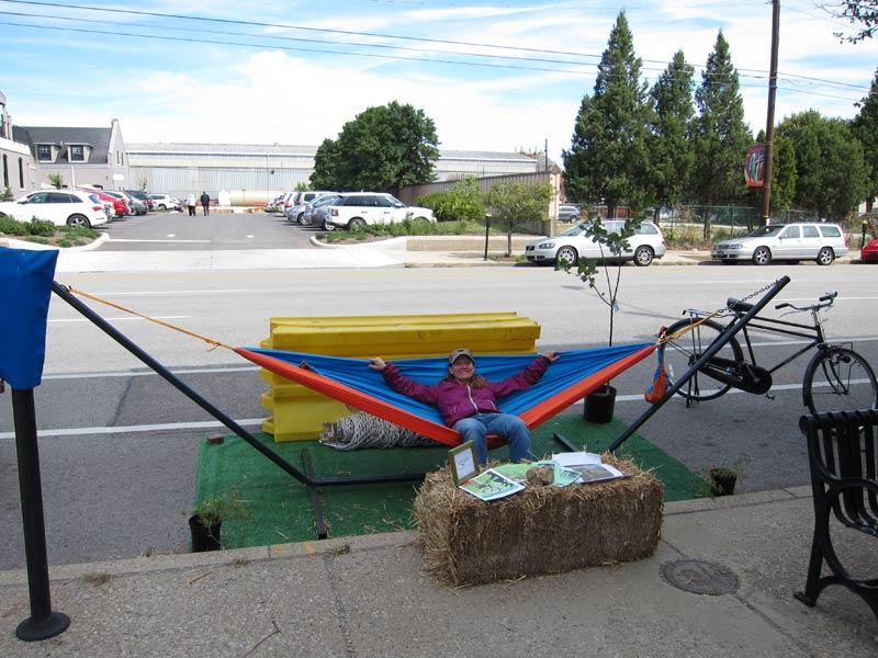 Sharon Neely relaxes on a hammock in front of The Green Building. (Branden Klayko)