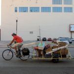 David Morse carries Park(ing) Day supplies on a bike trailer. (Mary Beth Brown)