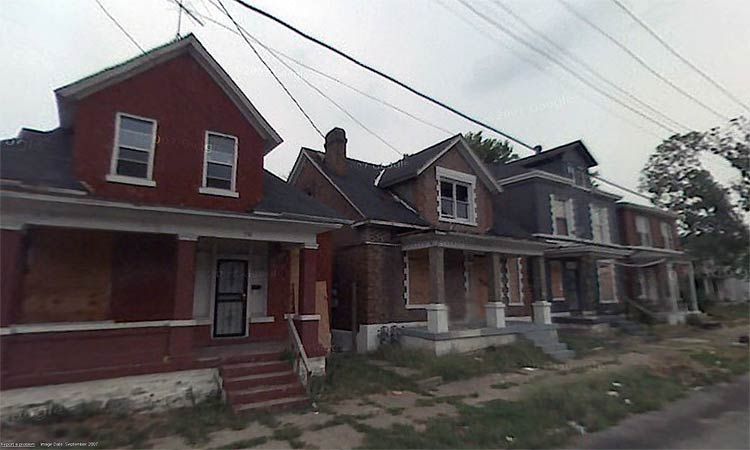 A row of brick houses is boarded up. (Google Maps)