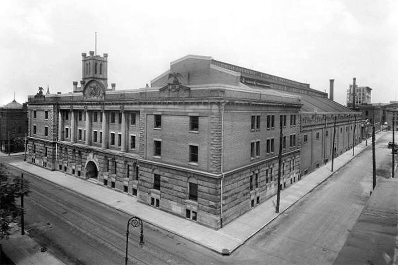 Louisville's Armory viewed in 1921, showing stone eagles perched atop its parapet. (Courtesy UL Photographic Archives - Reference URL)