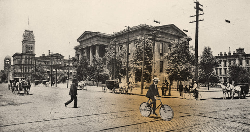 A cyclist in from of Metro Hall circa 1890. (Courtesy UL Photographic Archives; Montage by Broken Sidewalk)