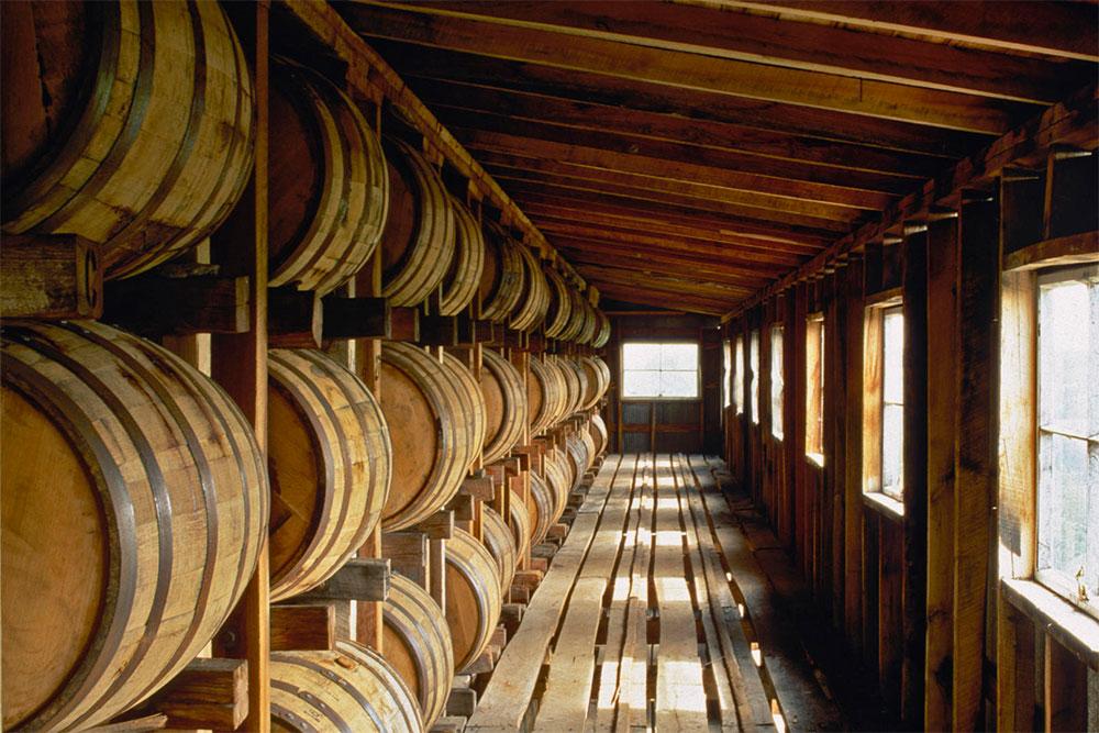 Bourbon barrels in a rick house. (rotterdamblues / Flickr)