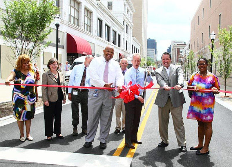 City officials cut the ribbon on Guthrie Street made back into a place for cars. (Courtesy Metro Louisville)