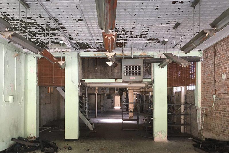 Inside the front of the Puritan Uniform Rental building still features a stamped metal ceiling. (Branden Klayko / Broken Sidewalk)
