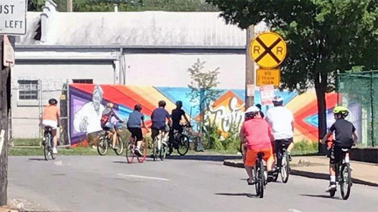 Riding down Goss toward the Three Points Mural. (Courtesy Louisville Forward)